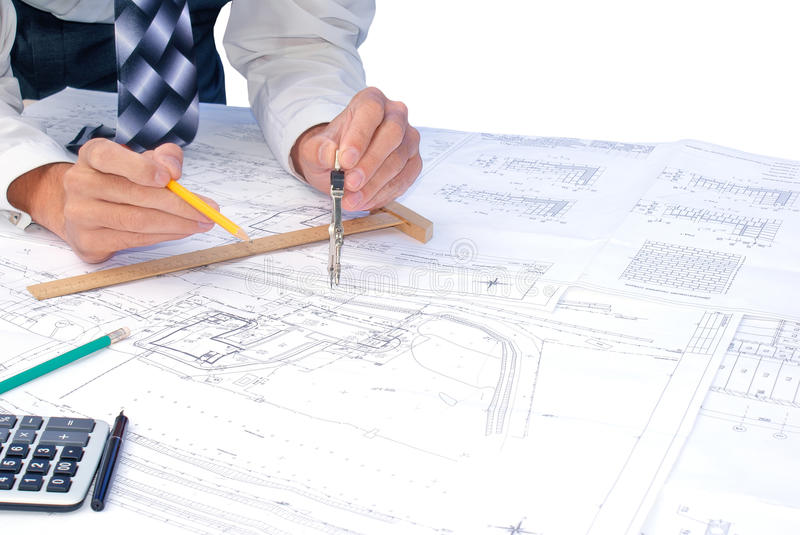 Draftsman. Projection -initial preparatory stage in construction new building royalty free stock photo