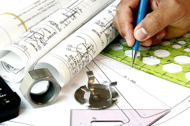 Draftsman with engineering plans royalty free stock photo