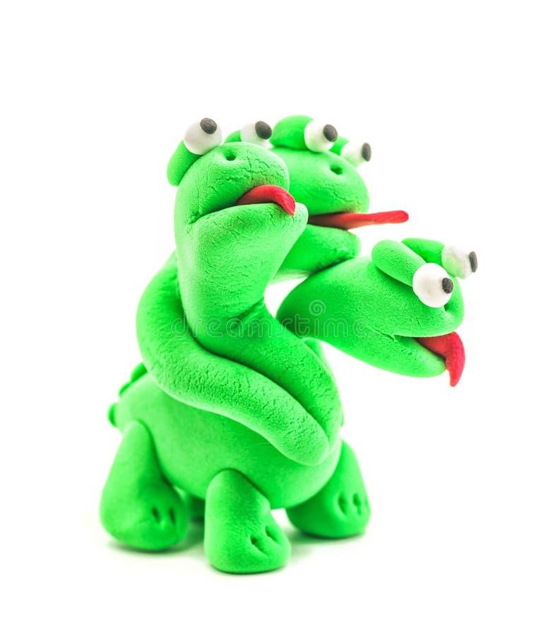 Dragão feito à mão verde da argila de modelagem com as três cabeças isoladas no branco fotos de stock