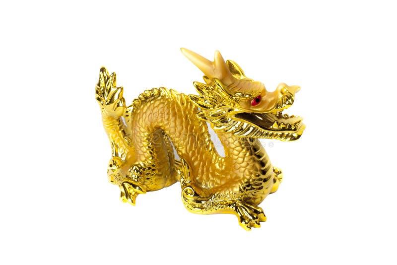 Dragón de oro aislado en el fondo blanco imagen de archivo