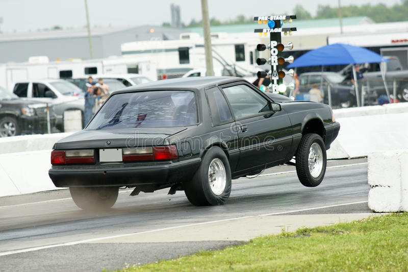 Drag car. Picture of the mustang coupe at the drag race stock images