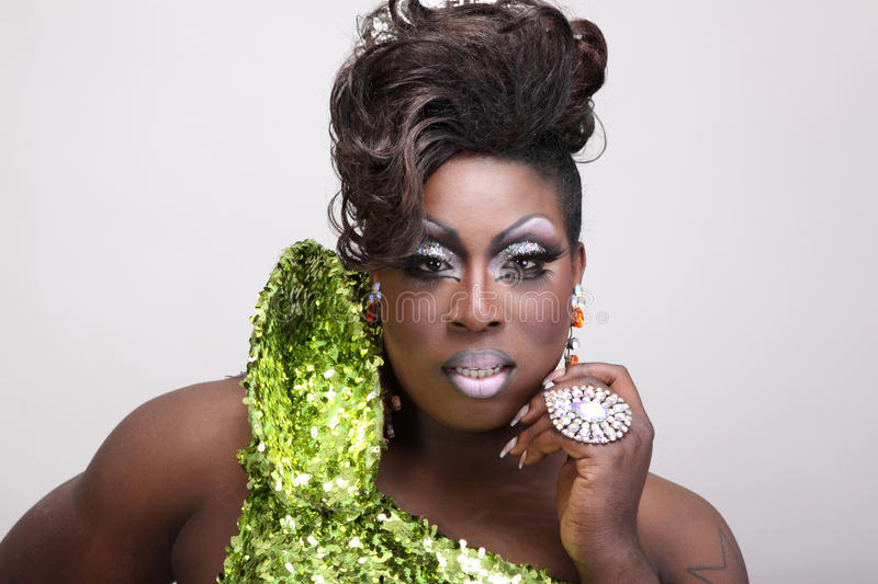 Drag queen. Wearing a green gown with sequins royalty free stock images