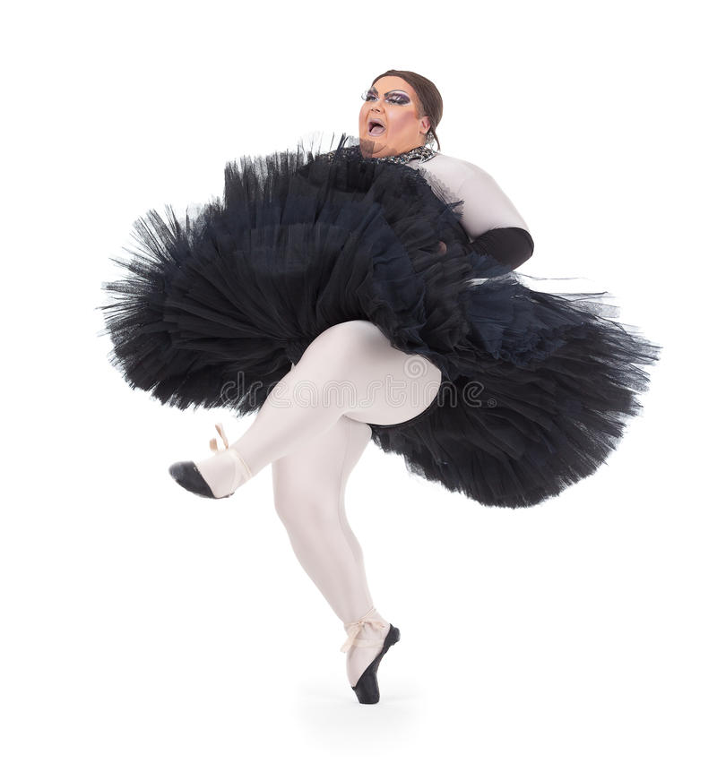 Drag queen dancing in a tutu. Overweight drag queen dancing in a tutu nimbly balancing on tiptoe with his foot raised in a fun caricature of a female ballet royalty free stock photo