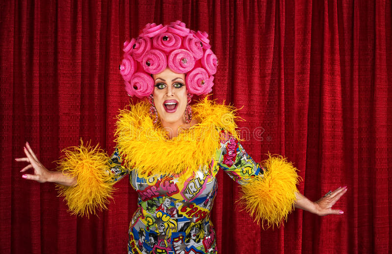 Drag Queen Performing. Big drag queen performing a song in theater stock images