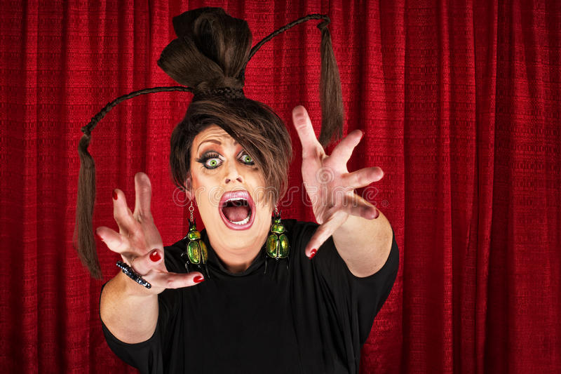 Drag Queen Reaching Out. Frantic Caucasian drag queen in theater reaching out stock photography
