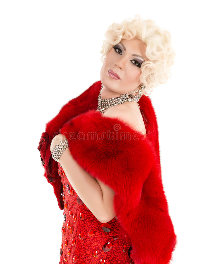 Drag Queen in Red Dress with Fur Performing. On white background stock photo