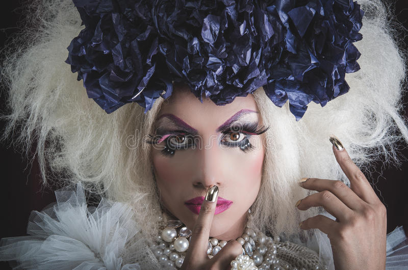 Drag queen with spectacular makeup, glamorous. Trashy look, posing while using hands and fingers stock photos