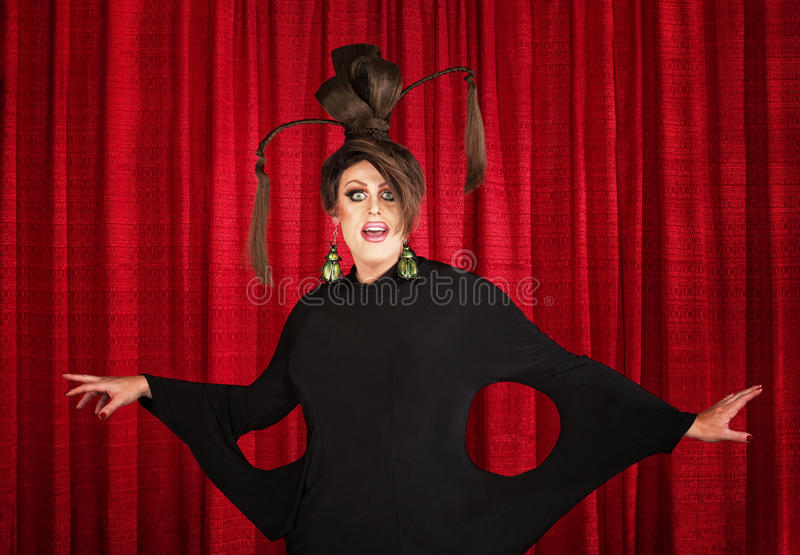 Drag Queen in Weird Dress. Smiling man in drag wearing unique dress and hairdo stock photo