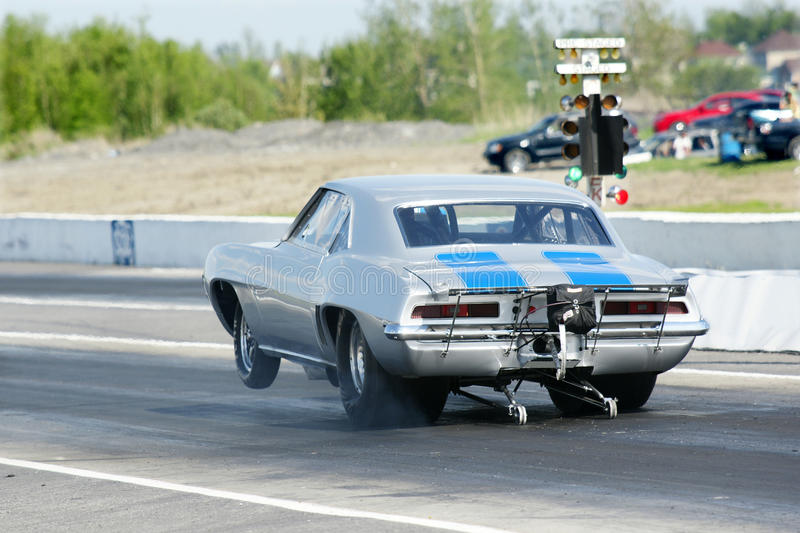 Drag race. Picture of the vintage camaro at the drag race stock photos