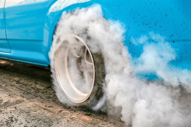 Drag racing car burn tire in preparation for the race. Drag racing car burns rubber off its tires in preparation for the race royalty free stock images