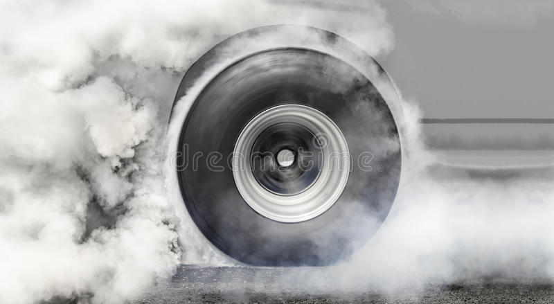 Drag racing car burns tires for the race royalty free stock photography