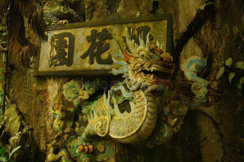Dragon. The dragon ascending the mountain. Symbol of power, it is present in all pagodas stock photography