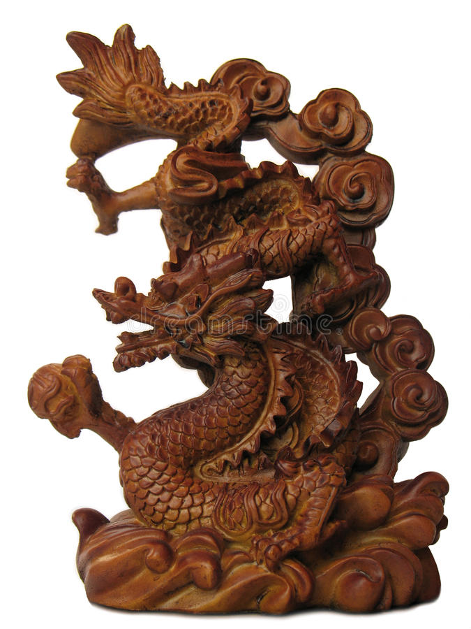 Dragon. Wooden Chinese dragon with a pearl, isolated on white royalty free stock images