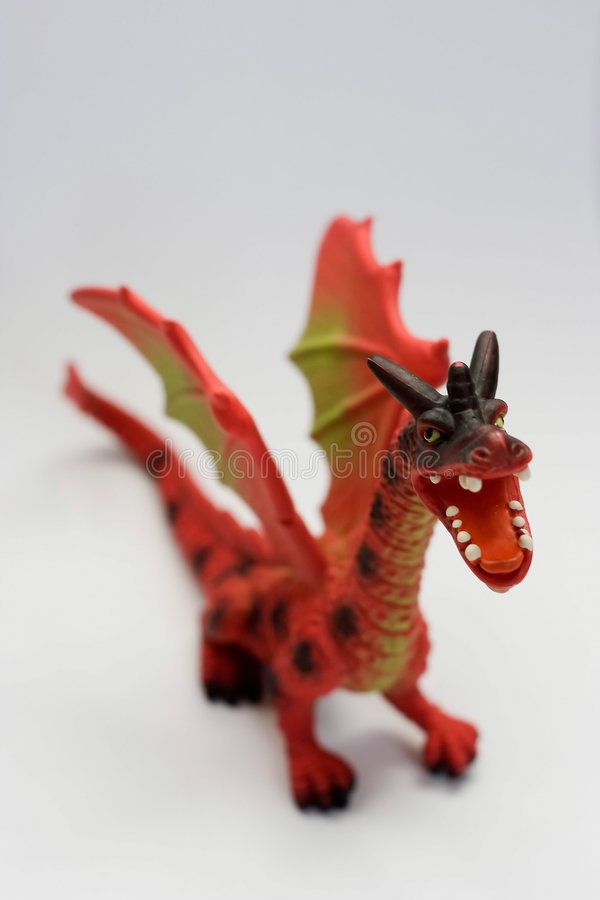 Dragon 2. Little red dragon toy against white background stock image