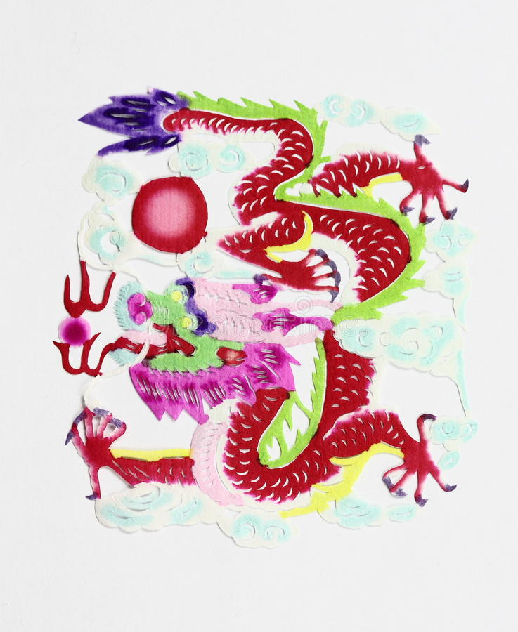 Dragon. Paper-cutting is a traditional Chinese folk art. Paper-cut of dragon represents power stock images