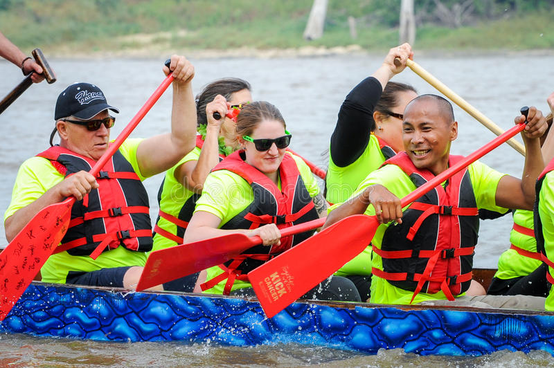Dragon boat race. September 12, 2015 – Red river in Winnipeg, MB, Canada – Team building activity during rowing dragon boat race royalty free stock photography