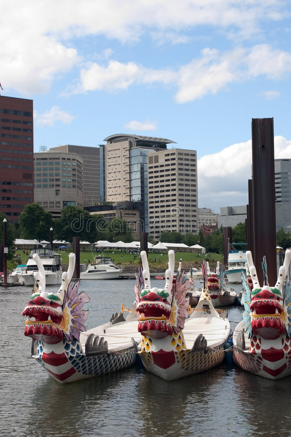 Dragon Boats. In a marina with Portland, Oregon in the background royalty free stock image