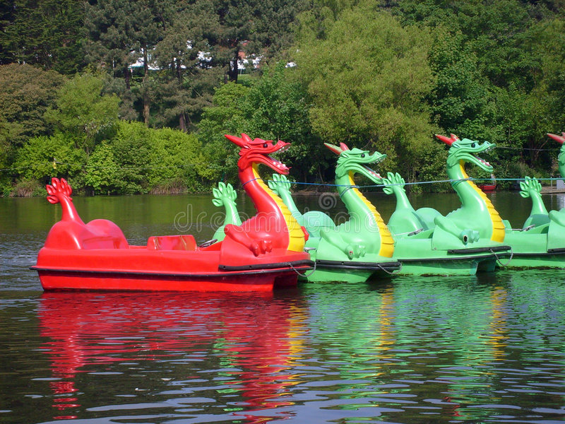 Dragon boats on boating lake. In Peasholm Park, Scarborough, England stock images