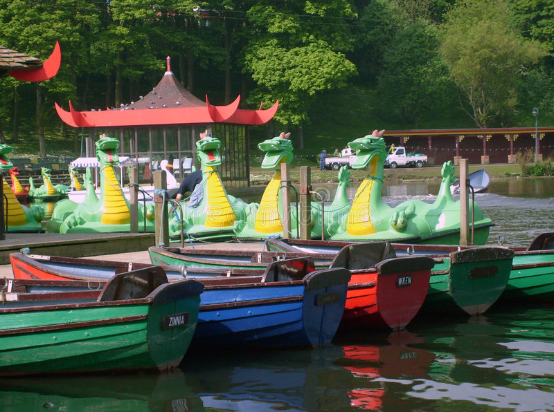 Dragon boats on boating lake. In Peasholm Park, Scarborough, England stock photography