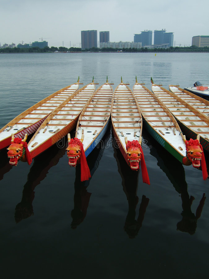 Dragon Boats and Buildings. In a park royalty free stock photography