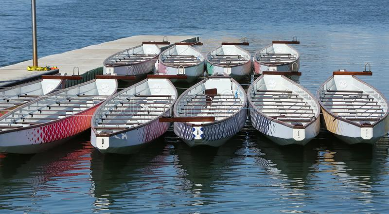 Dragon Boats on the dock. In the bay stock photo