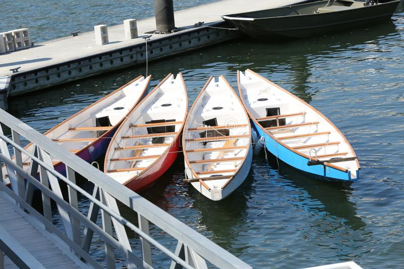 Dragon Boats on the dock. In the bay stock photos