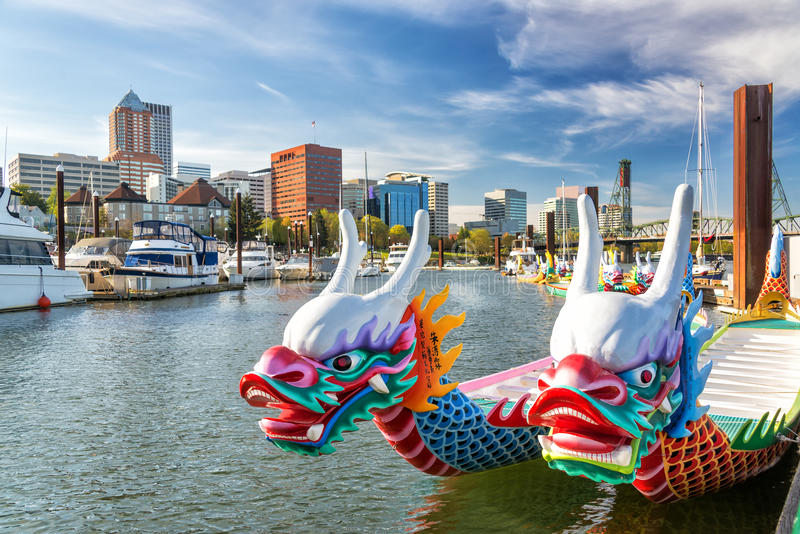Dragon Boats and Downtown Portland. Dragon boats on the Willamette River with downtown Portland, Oregon in the background stock photography