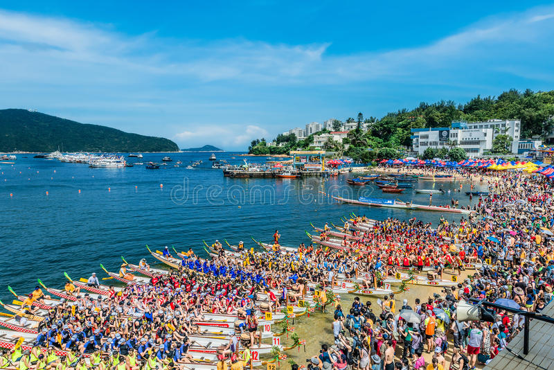 Dragon boats festival race Stanley beach Hong Kong. Hong Kong, China- June 2 , 2014: People racing the Dragon boats festival race in Stanley beach royalty free stock photography