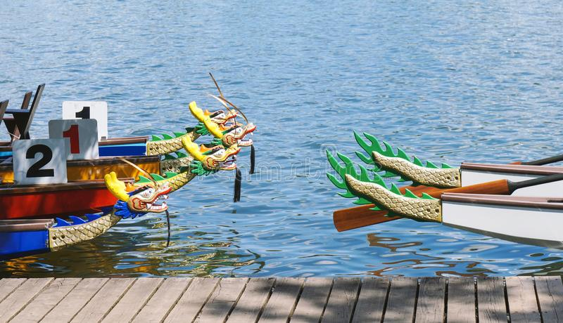 Dragon boats moored at wooden jetty royalty free stock photo