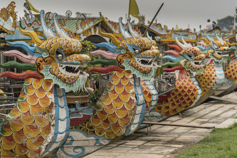 Dragon boats on the Perfume river Hue. These dragon boats are used on the Perfume river that runs through Hue in Central Vietnam, Some are single hulled others stock photography