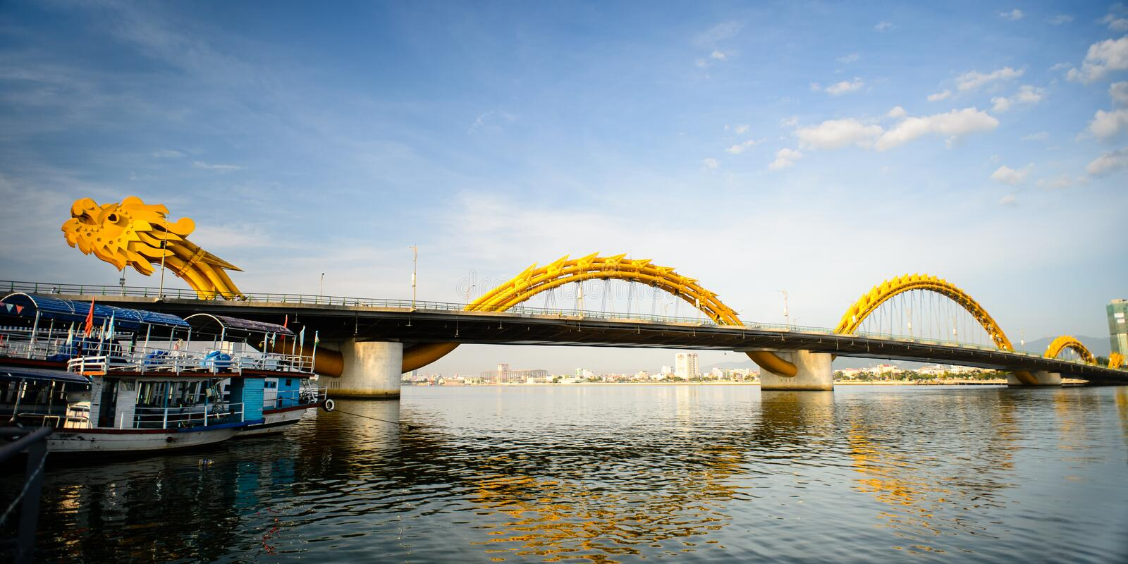 Dragon bridge cross Han river at Danang city. Dragon bridge cross Han river with reflection at Danang city, Vietnam in August 15th 2014 stock image