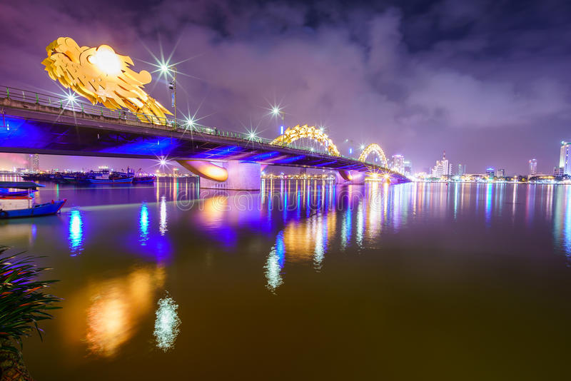 Dragon bridge cross Han river at Danang city in Vietnam. Dragon bridge cross Han river at Danang city at night in Vietnam. Danang is separated from Quang Nam royalty free stock photo