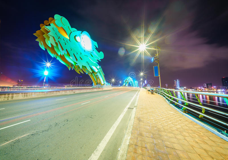 Dragon bridge cross Han river at Danang city in Vietnam. Dragon bridge cross Han river at Danang city at night in Vietnam. Danang is separated from Quang Nam stock photos