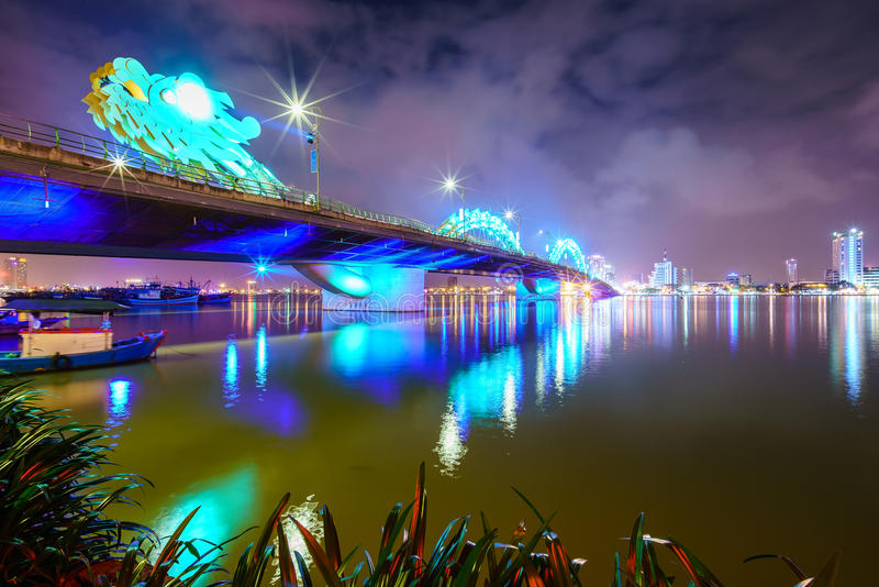 Dragon bridge cross Han river at Danang city in Vietnam. Dragon bridge cross Han river at Danang city at night in Vietnam. Danang is separated from Quang Nam royalty free stock photos