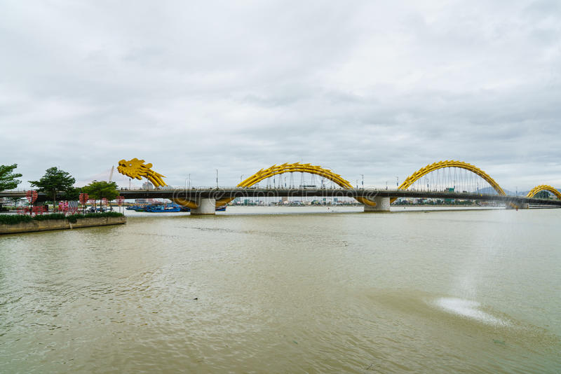Dragon bridge cross Han river at Danang city in Vietnam. Danang is separated from Quang Nam province and is one of five independent municipalities in Vietnam royalty free stock photography
