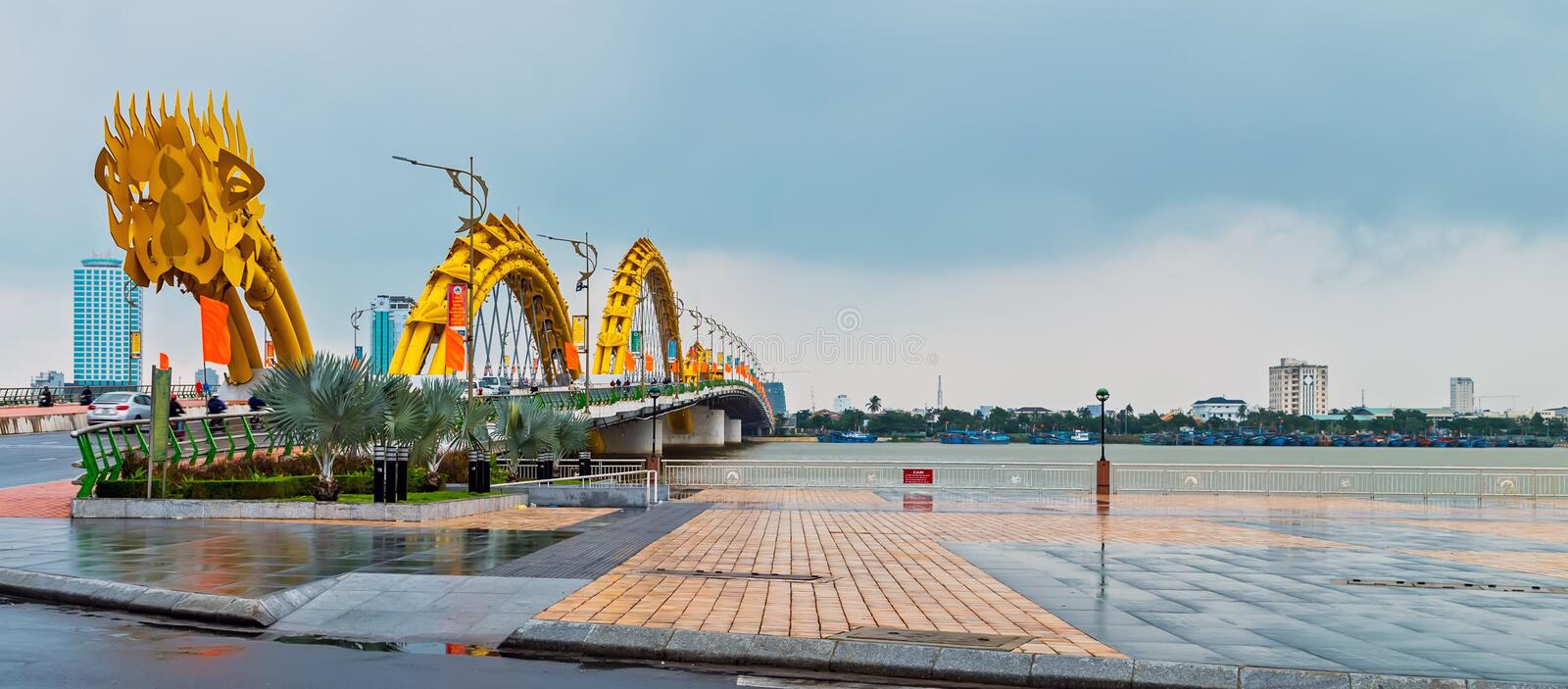 Dragon Bridge in Da Nang Han river in Vietnam. Da Nang, Vietnam - December 11, 2014: Attractions Dragon bridge electricity, designed and built in the shape of a stock photos