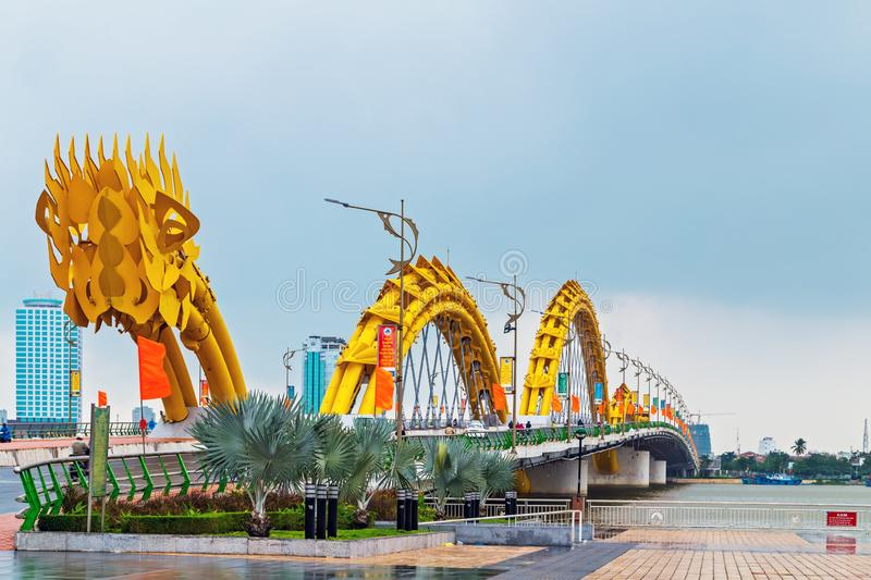 Dragon Bridge in Da Nang Han river in Vietnam. Da Nang, Vietnam - December 11, 2014: Attractions Dragon bridge electricity, designed and built in the shape of a royalty free stock image