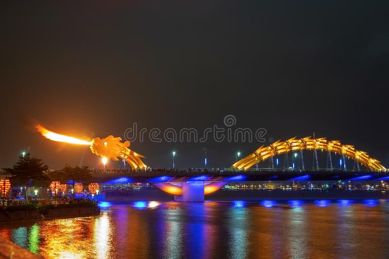 Dragon bridge in Da Nang, Vietnam, at night. The dragon blowing hot fire out of its mouth. A famous attraction in Da Nang. Dragon bridge in Da Nang, Vietnam, at stock images