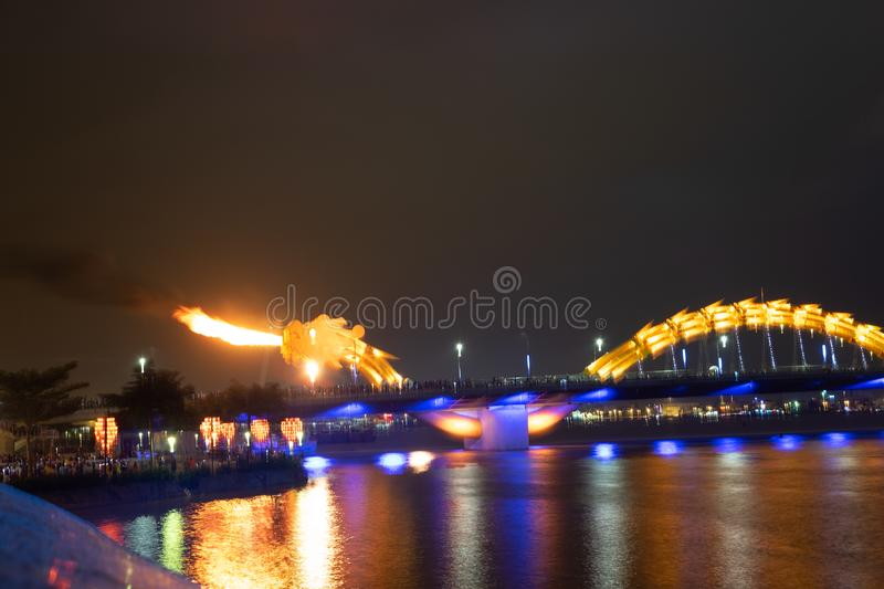 Dragon bridge in Da Nang, Vietnam, at night. The dragon blowing hot fire out of its mouth. A famous attraction in Da Nang. Dragon bridge in Da Nang, Vietnam, at stock image