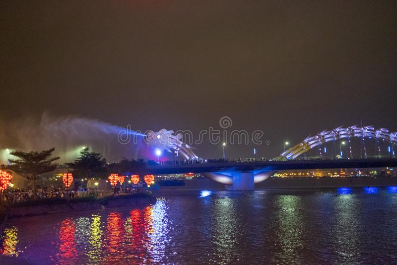 Dragon bridge in Da Nang, Vietnam, at night. The dragon blowing hot fire out of its mouth. A famous attraction in Da Nang. Dragon bridge in Da Nang, Vietnam, at royalty free stock images