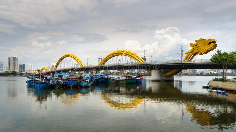 The Dragon Bridge is a bridge over the River Hàn at Da Nang, Vietna. M.The bridge was designed and built in the shape of a dragon and to breathe fire and stock images