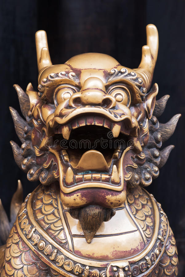 Dragon bronze statue in a chinese buddhist temple. Chengdu, China royalty free stock image