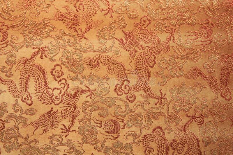 Dragon conçu sur le tissu photographie stock