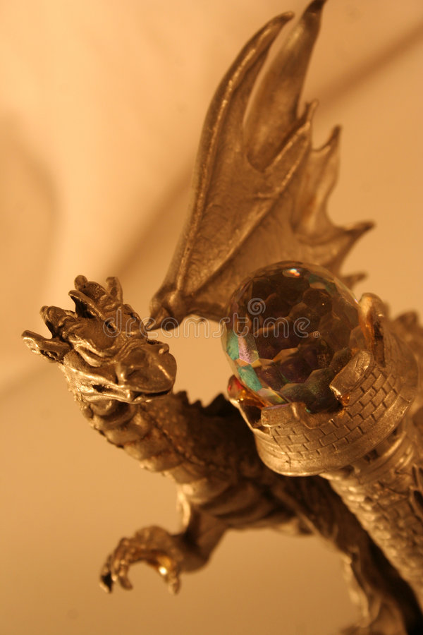 Dragon with crystal ball royalty free stock photography
