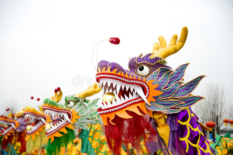 Dragon dance. Simplified Chinese: 舞龙; traditional Chinese: 舞龍; pinyin: wǔ lóng is a form of traditional dance and performance in stock image