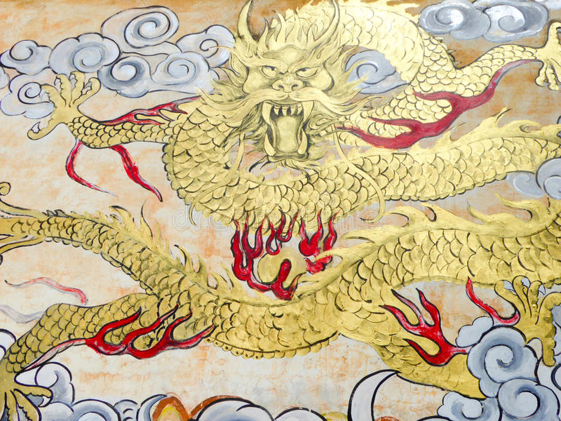 Dragon drawing. A golden dragon painting on the wall from China royalty free stock photography