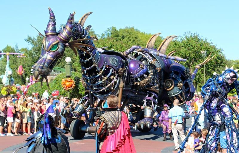 A dragon float in a parade at Disneyworld. Colorful dragon parade float at Disney's Magic Kingdom royalty free stock image