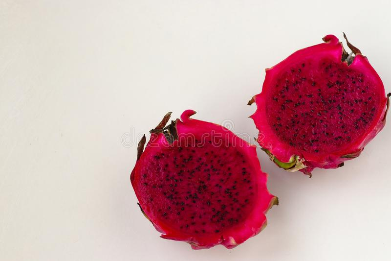 Dragon fruit are located on a white background royalty free stock photography