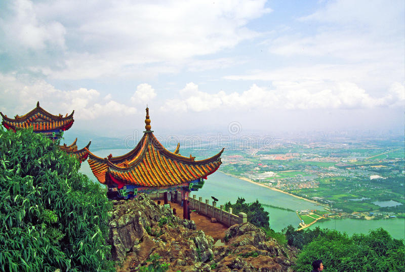 Dragon gate in kunming. Photo of traditional chinese architecture with large vistas of space down below in background. Location: Dragon Gate, Kunming, Yunnan stock photos