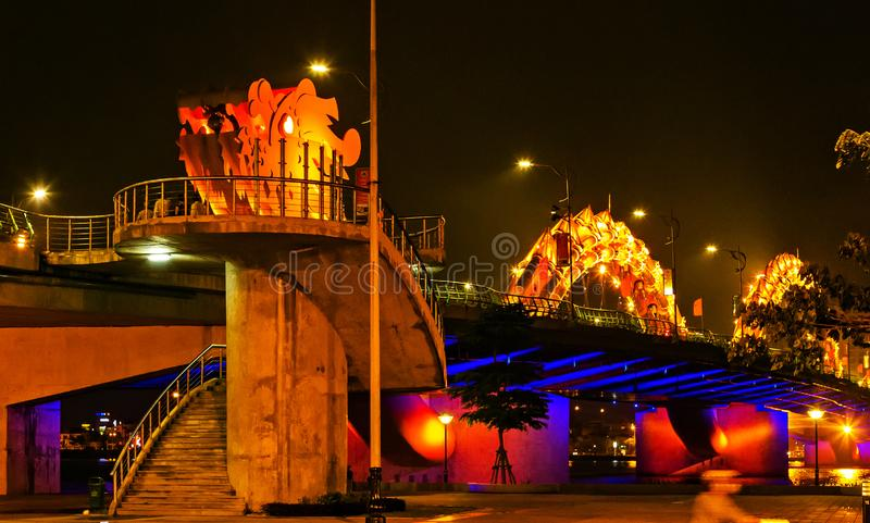 Dragon golden Bridge Han river in Da Nang in Vietnam. Dragon Bridge in the evening as it is illuminated with colourful LED lights, Han river in Da Nang, Vietnam royalty free stock images